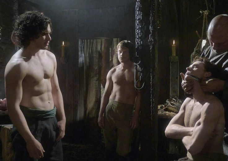 Game of Thrones (series 2011 - ) Starring: Kit Harington as Jon Snow, Alfie Allen as Theon Greyjoy, and Richard Madden as Robb Stark. Grooming for the arrival of the king and his entourage.