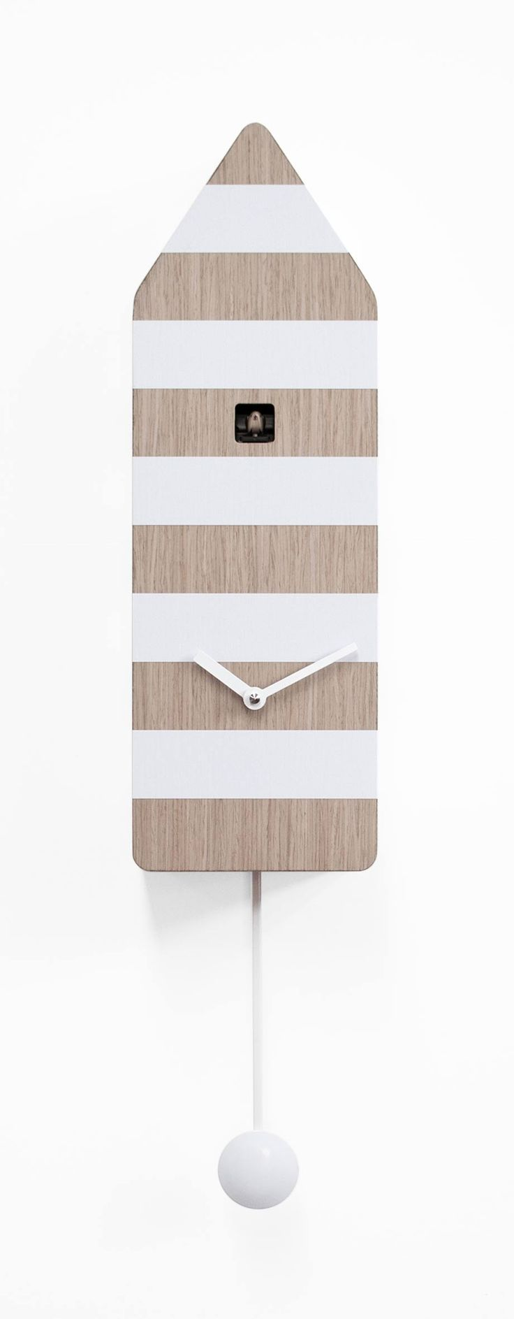 Capri it's a modern design cuckoo clock, in painted wood with horizontal colored bands. The cuckoo by bright colors and clean lines reminiscent of the cabins bathing facilities but with the typical lighthouse colors. A simple object that contains so many emotions and memories.