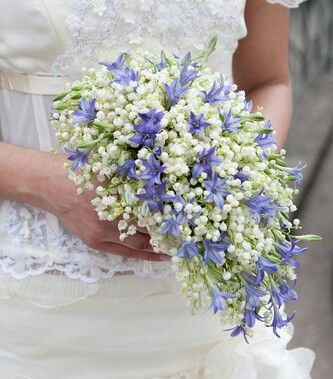 {A Lovely Teardrop/Shield Bridal Bouquet Featuring White Lily Of The Valley & Violet Hyacinth}