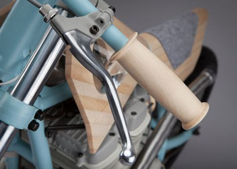 Italian design studio Joe Velluto has collaborated with motorcycle company NorthEastCustom to make a bike-shaped piece of furniture that replaces metal and plastic with glass, wood and wool.