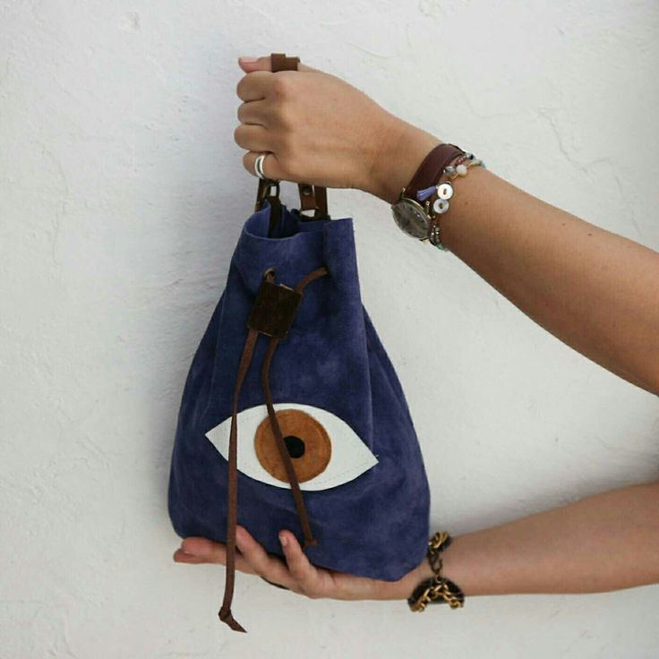 Super soft texture+rich blue color+the evil eye= an irresistible little piece of (handmade) work.