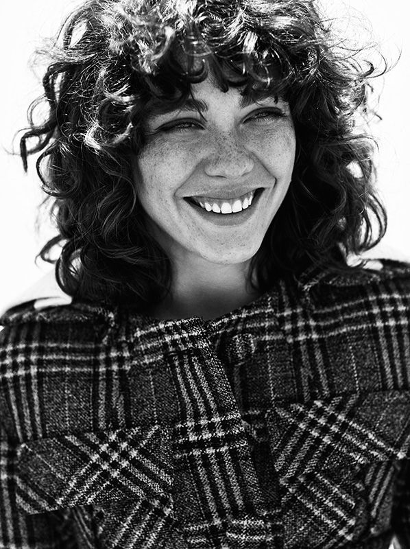 Steffy Argelich is all smiles in a plaid Prada jacket