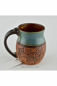 Pottery Mug with a Saying - Teal with Carved Brown Flower Band