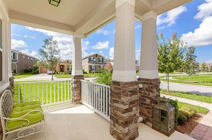 Traditional Porch with exterior stone floors, exterior brick floors, Wrap around porch, Pathway