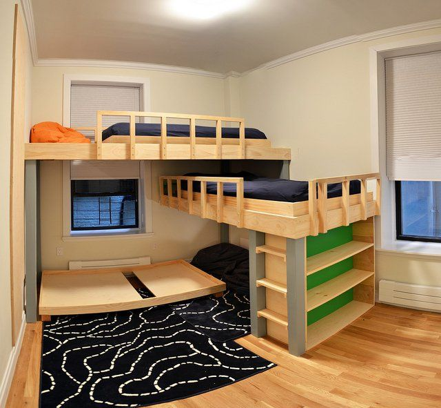 "We finally built a ""triple bunk bed"" for our 3 boys–ground level mattress wasn't in place yet when we photographed. Also, the wall to the left is a climbing wall–ordered climbing holds from REI and they are perfect! photo by jwild, via Flickr"