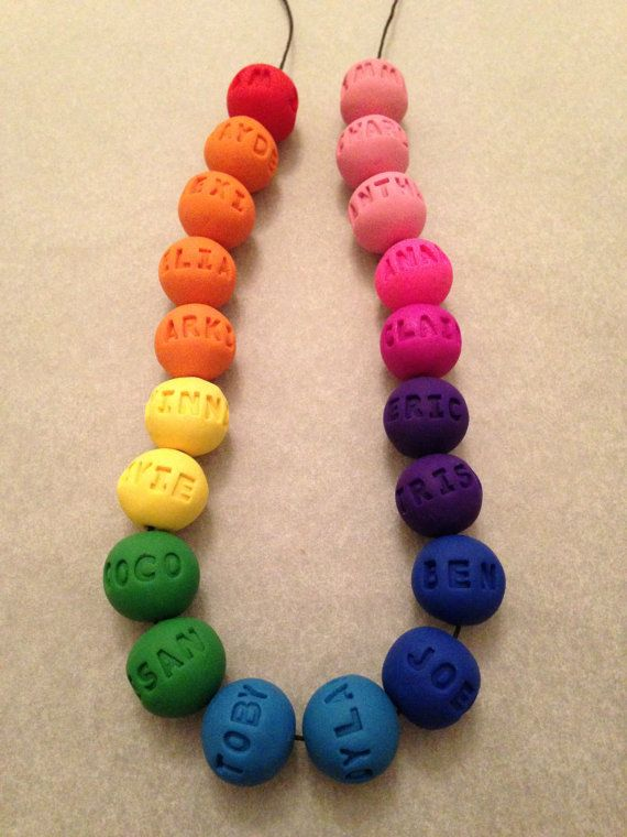 Gorgeous gift for a teacher, each bead has been stamped with a child's name.