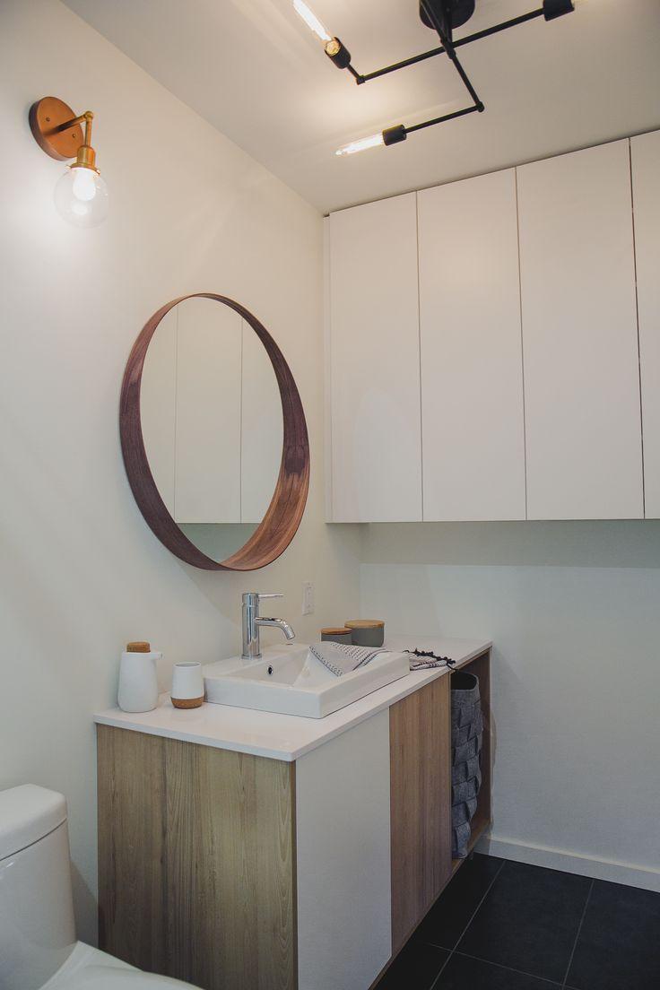 luminaire authentik et mirroir de la salle de bain de la maison modèle du projet immobilier Faubourg 1792 à Bromont