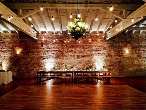 Edsion lights over dance floor, floral basket chandelier and up lighting at Bakery 105 - Created by High Performance Lighting