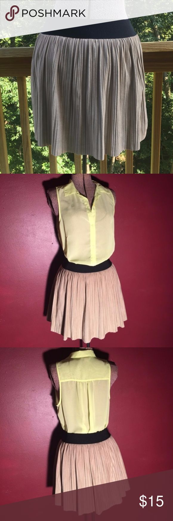 BCBGMAXAZRIA Kaysa Khaki Pleated Mini Skirt XS BCBGMAXAZRIA 'kaysa' pleated mini skirt in excellent used condition. The skirt has a fitted black waistband and an attached liner underneath as pictured.  Shell: 92% polyester 8% spandex. Lining: 64% cotton 33% nylon 3% spandex. Dry clean only.  Laid flat: waist is 13 1/2 inches  length from top to bottom is about 15 1/2 inches. BCBGMaxAzria Skirts Mini