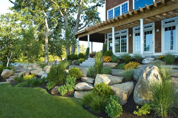 Rock front yard landscape beach style with boulders for Decorative boulders for yard