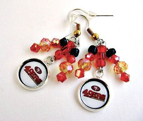 NFL San Francisco 49ers Football Earrings by SportsJewelryStudio on Etsy.   Football season starting soon! More teams available in several unique designs. Custom orders welcome. 5-Star customer rating. Quick shipping. Free gift wrap. etsy.com/shop/sportsjewelrystudio