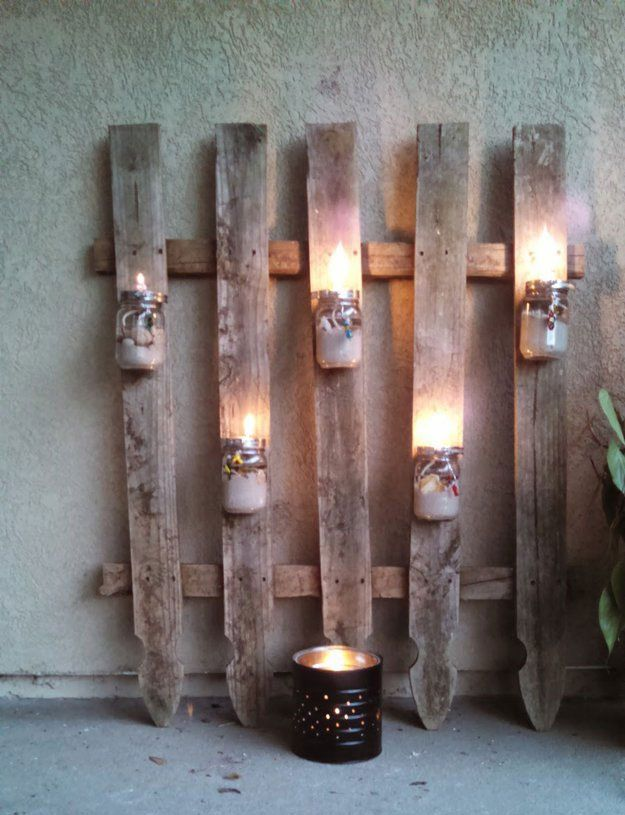 Mason Jar Lighting Project - upcycle your palletes and mason jars to make this cool backyard decoration! | 14 Pallet Projects For Your Garden This Spring