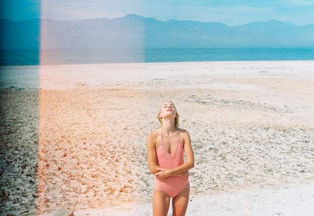 light leak pink blue and nude photograph editorial sand swimsuit