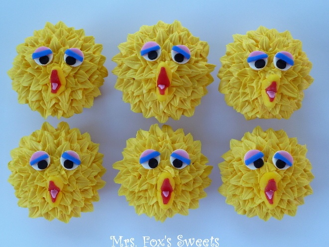 This looks kinda scary, but cute at the same time....I think. Mrs. Fox's Sweets: Big Bird Cupcakes