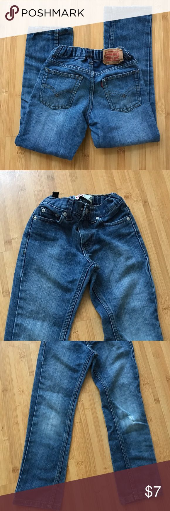 Levi's 511 slim jeans Slim jeans. Inside adjustable waist. VGUC. Small wear in leg by knee. Looks like it was meant to be that way. Levi's Bottoms Jeans