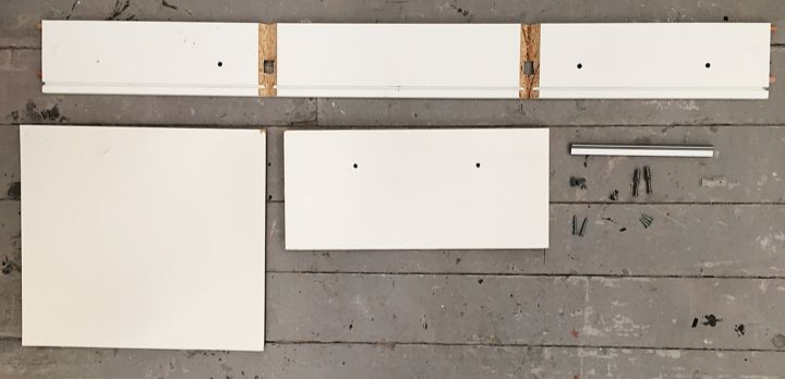 INVENTORY of  x1 chipboard, white painted drawer.  X1 sides of object (joint parts) X1 white painted cardboard base X1 front piece X1 metal handle X2 silver plastic screws X2 long shaped screws X2 metal screws (long) X2 screws (small) X2 clear, plastic components