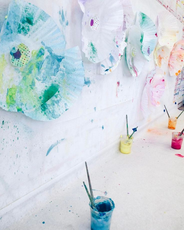 our sensory wall is a highlight of our toddler art classes. there's always something new fun and BIG to play and get creative with. our littlest artists appreciate getting to stand at the wall and get their wiggles out with some large scale art. these oversized coffee filters bedazzled with liquid watercolor in spray bottles and painted with colored shaving cream made for lots of fun! sign up on our website or call us today to reserve your spot in our escort your artist class. #sensoryart…