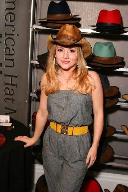 Kelly Stables from The Exes wearing a honey Cyclone with a western pinched crown and flipped up brim