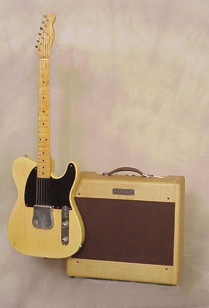 1953 Fender Esquire guitar with Fender Deluxe amplifier.  I'd love this setup.