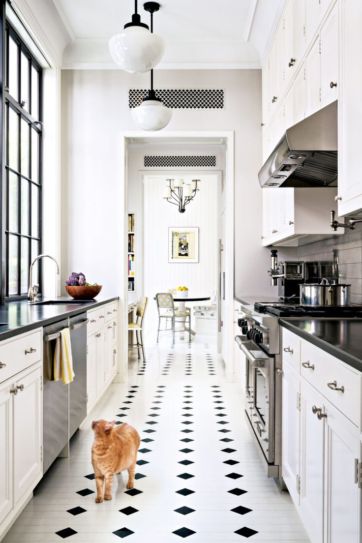 NYC. Painted wood floors. White cabs, black counters, stainless tile backsplash.