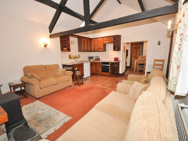 Open plan living area with vaulted ceiling #holidaycottage