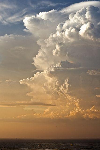 Towering cumulonimbus clouds above Siracha, Thailand.
