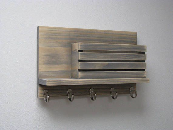 This piece is stained and than conditioned to give it its unique rustic, weathered and aged look. The mail slot is large enough for a legal size envelope, standard magazine or even a large book. It comes with not two or three hooks but five for your needs. All stain choices will
