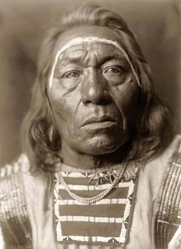 Here we present a dramatic image of Leads Wolf, a Crow Indian. It was taken in 1908 by Edward S. Curtis.    The image shows this Crow man with his Face Paint.