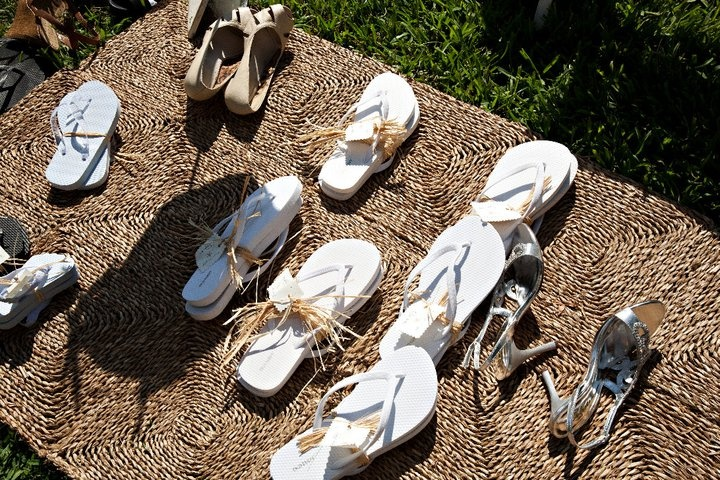 Flip Flop Station.  The guests were asked to kick of their shoes and grab a pair of flip flops for the beach wedding ceremony.  I bought the flip flops from Old Navy at season's end for $1.00 each.