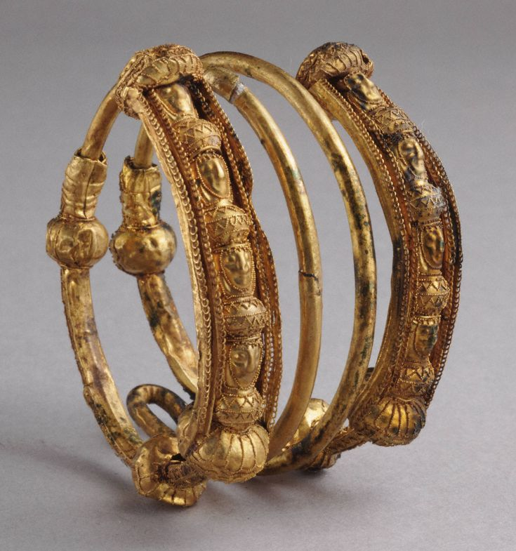 Etruscan Hair ring with female heads, 7th century B.C. Gold