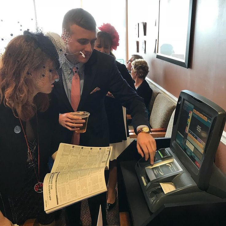 Its a family moment when your older brother teaches his younger sister how to operate the betting machine at Churchhill downs.
