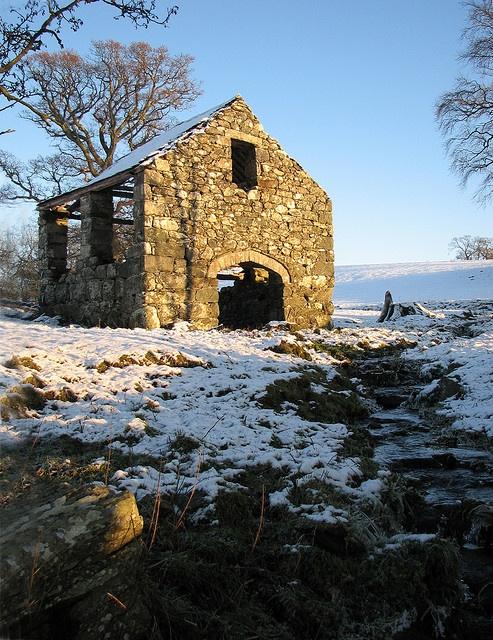 old stone barn in snow--still standing, wouldn't it make a wonderful hidden garden?