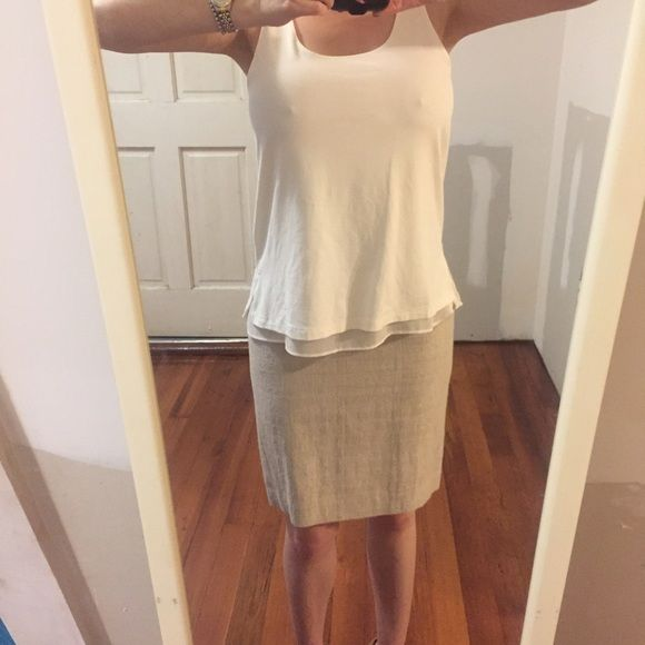 Ann Taylor NWOT cream cami top/shell Ann Taylor double layer cami top/shell with sheer under layer that hangs under a knit top layer. I have two that I'm selling, both new, but this one I cut the tags off. It has only been tried on. Perfect condition, just don't like the way it looks on me. Ann Taylor Tops Camisoles