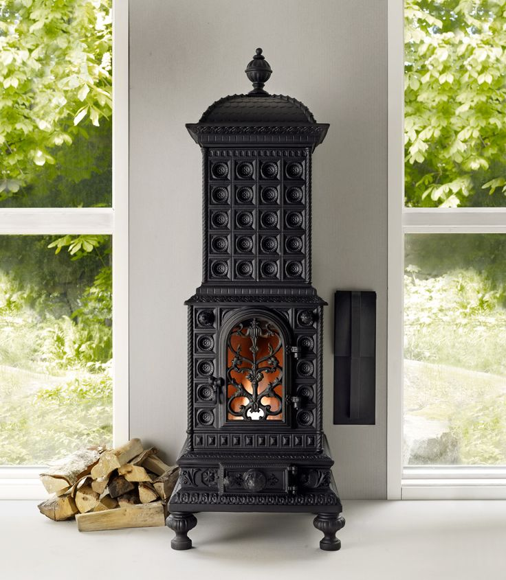 royal viking : cast iron stove  I want this instead of a fireplace.  Beautiful.