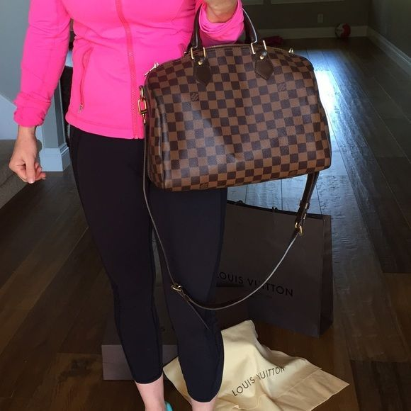 LV Speedy Bandouliere 30 Damier Ebene Bought in 2013 in Vegas. It was my very first LV. It's in fantastic shape!!! It's so light and has a strap for convenience. I paid $1,350 plus tax. It comes with the original box, dust bag and shopping bag. The only thing I'm missing is the lock which I misplaced. Some stains on the inside, but it's very clean! The outside looks almost brand new! Handles are still perfect. Louis Vuitton Bags