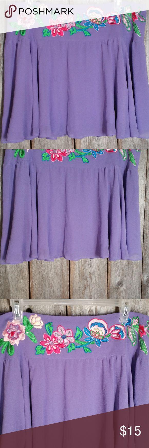 Moda International 12 Mini Skirt Purple Silk Moda International 12 Mini Skirt Women's Purple Silk Embroidered Skater Boho Gently used Back zipper closure Lined 100% silk Approx waist 34 and 16 in length Moda International Skirts Mini