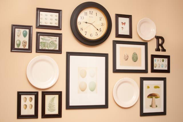 gallery wall with the frames, plates and clock...maybe eliminate the plates and replace with initial letter of last name? Pop in a ledge?