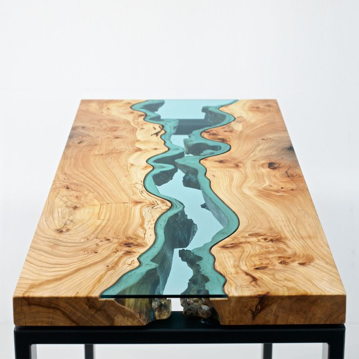 """Modern furniture from extraordinary materials by studio furniture artist Greg Klassen. The """"River Collection"""" is a fresh take on the wood slab table. The wood's edges marry with vibrant inlays of blue glass to evoke a river's meandering lines. Available in custom sizes, ranging from coffee to boardroom tables."""