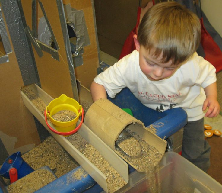 combining apparatus cardboard tubes embedded in a cardboard divider from tom bedard sand and water tablesand