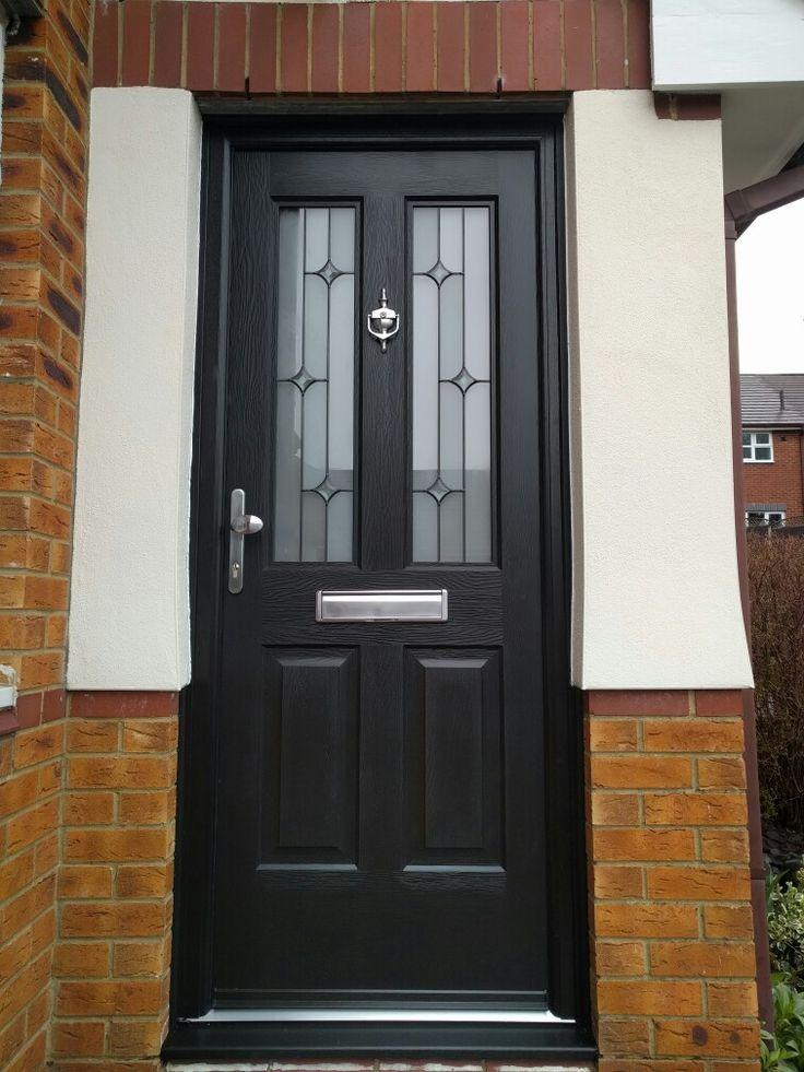 Black on black composite front door fitted in berkamstead