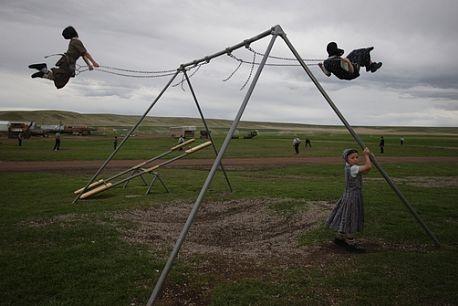 I can feel it!  I used to swing so high I'd go over the top bar!  Photo:  Thank you, William Albert Allard.