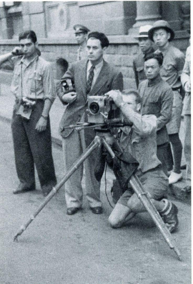 Robert Capa and his Contax II in han-Kou, China, with Joris Ivens and John Fernhout,