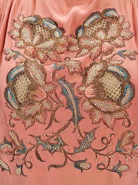 Evening blouse Designer: Elsa Schiaparelli (Italian, 1890–1973) Date: summer 1940 Culture: French Medium: silk, metal Dimensions: Length at CB: 26 in. (66 cm) Credit Line: Brooklyn Museum Costume Collection at The Metropolitan Museum of Art, Gift of the Brooklyn Museum, 2009; Gift of Arturo and Paul Peralta-Ramos, 1955