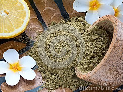 Tiare flowers,lemon and henna powder in coconut bowl