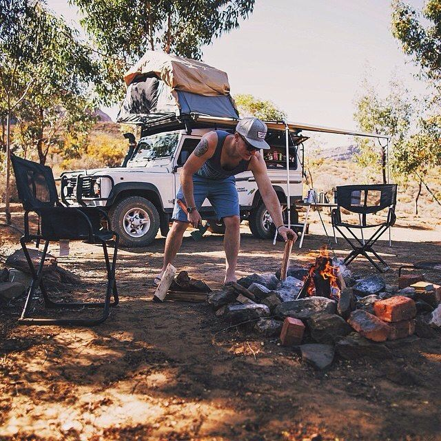 Unroll Awning. Check. Flip open Roof Top Tent. Check. Unfold table. Check. Expand Chairs. Check. Make fire. Check. Sit back and soak in all that life has to offer.... _______________  While @mrbenbrown was exploring #Africa.  _______________ #frontrunneroutfitters #outdoors #camp #landrover #defender #landy #travelgram #camping #overland #adventure #seetheworld #traveller #pumbathelandy