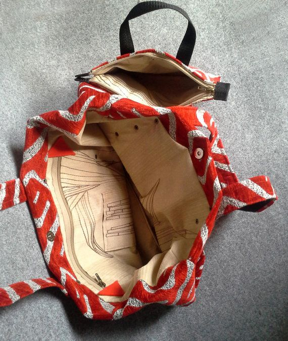 Large bag to carry on shoulder is made of thick fabric with red pattern (chenille). Large, soft, beautifully arranged.  The outer layer is a thick fabric in gray with red...