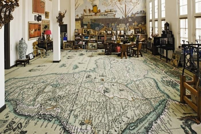 Great inspiration for the library I will have in my future house. The world map rug is wonderful.