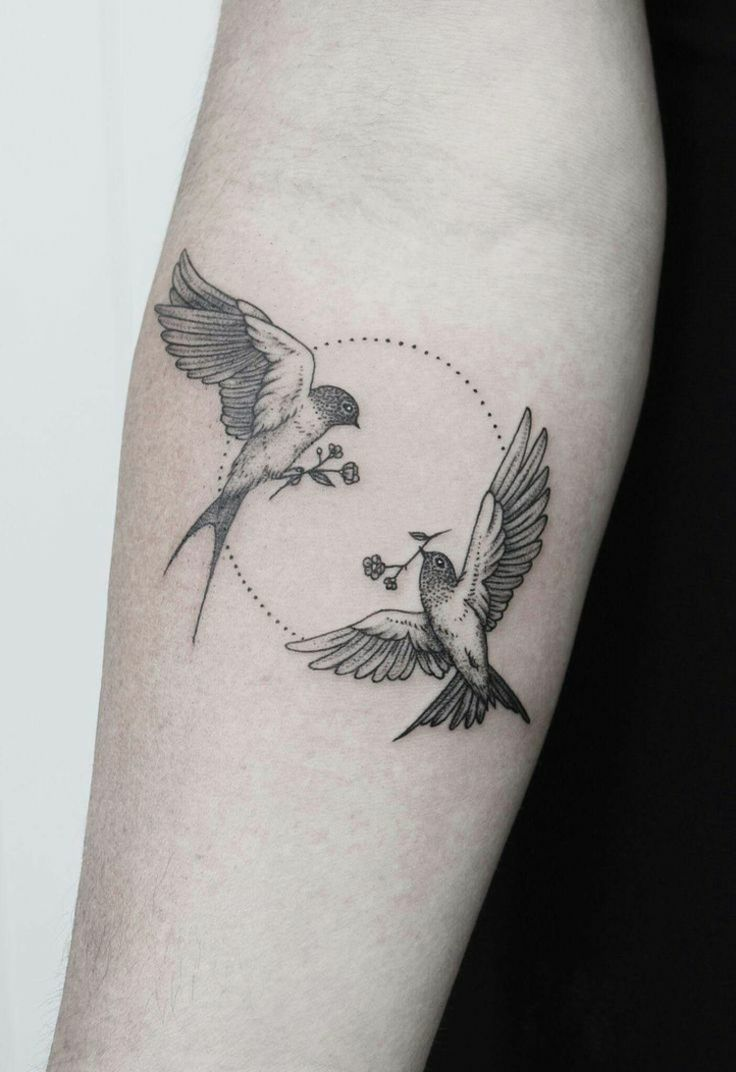Symbol love with swallows as arm tattoo