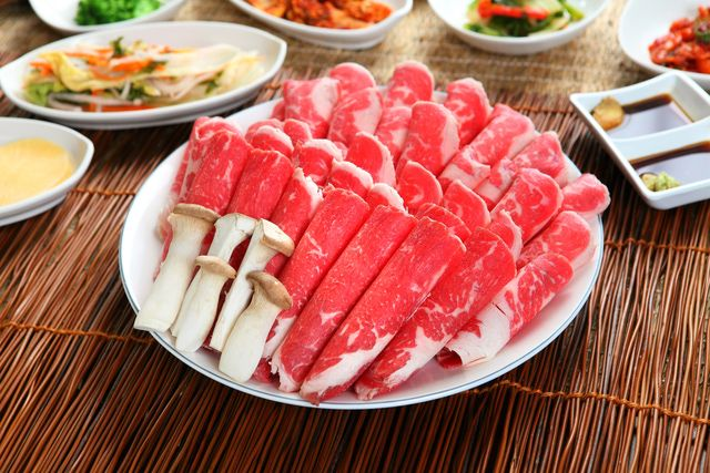 Chadol Baegi, a staple of Korean BBQ, is shaved beef brisket. It's cooked quickly on the grill and dipped in a sauce of sesame oil, salt, and pepper.