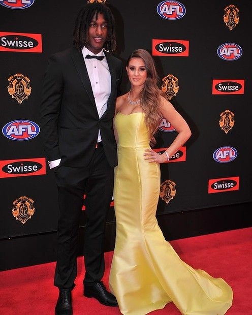 Nic Naitanui and Elle Demasi. gorgeous necklace to compilment stunning gown Brownlow 2013